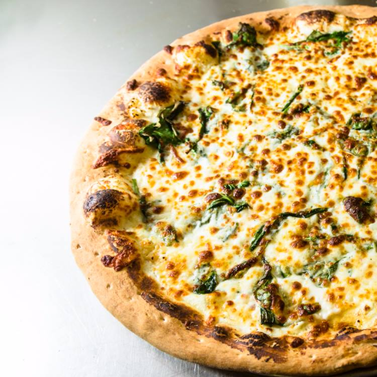 pizza with cheese and spinach