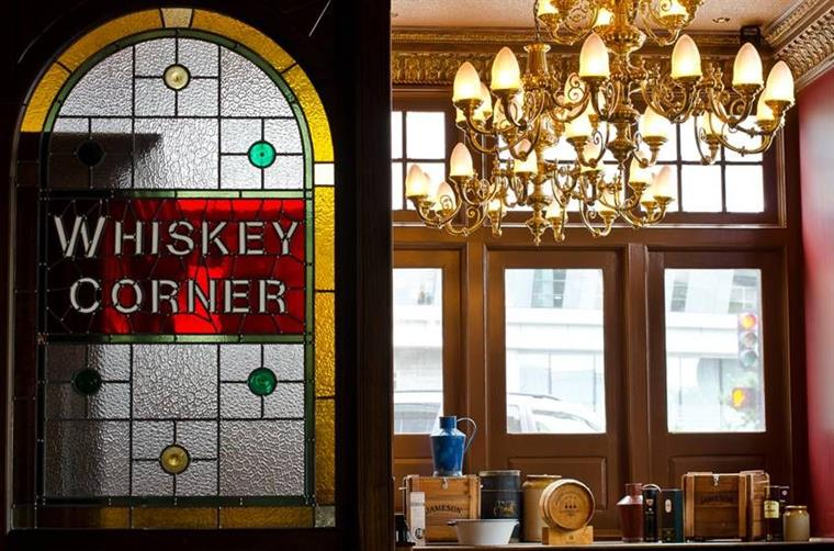 "A glass window that says ""Whiskey Corner"""