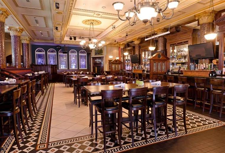 The inside view of The Dublin with empty, set tables