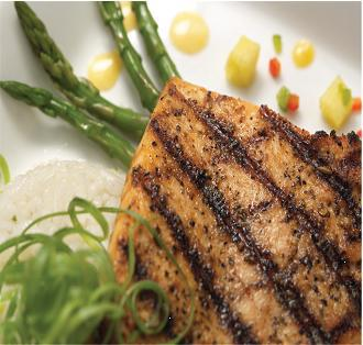 grilled chicken over asparagus and corn