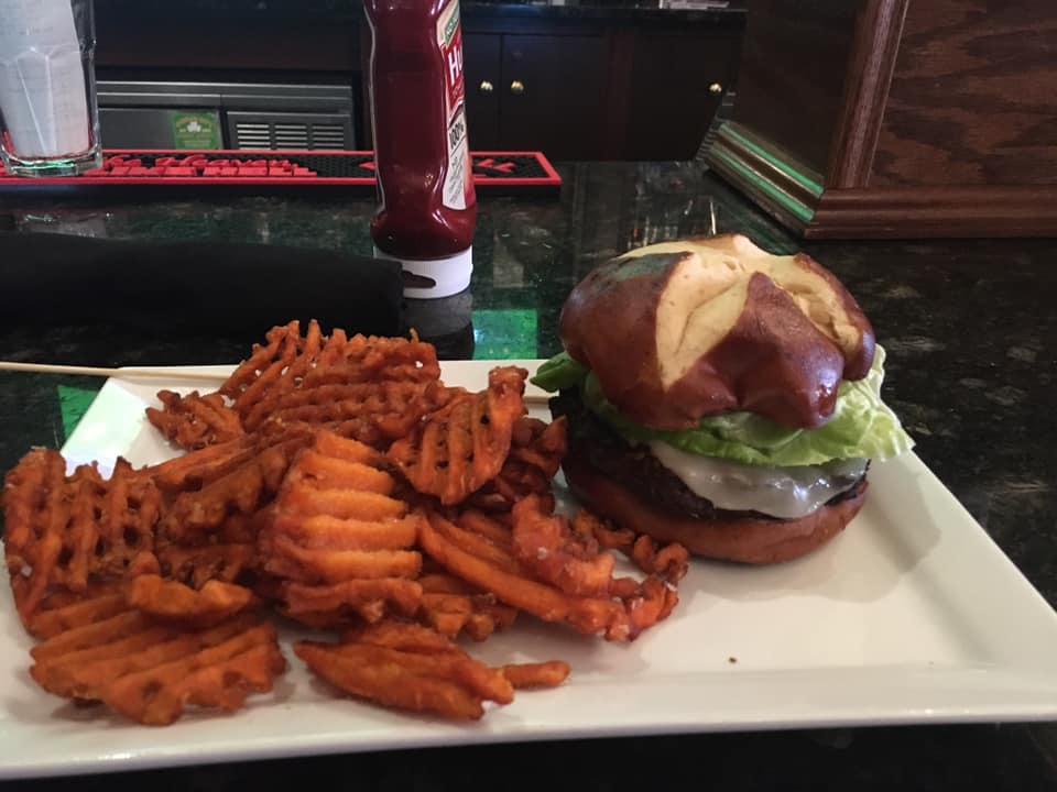 A sandwich with a side of waffle sweet potato fries