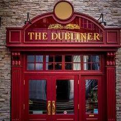 Giant doors that Say The Dublin in the front of the building