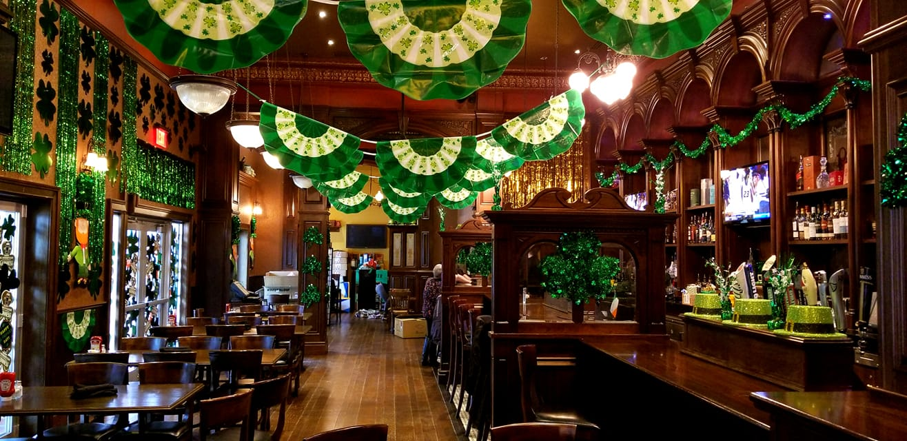 The inside of The Dublin decorated with flags
