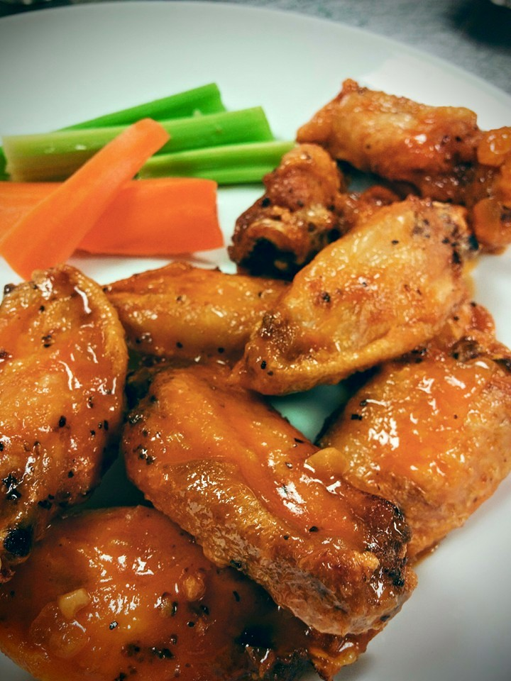 Buffalo chicken wings with celery and carrots on the side