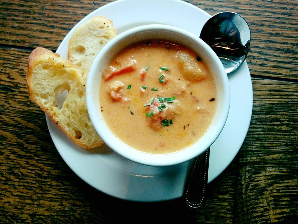 A creamy soup with a side of toasted bread