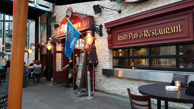 an outside view of The Dublin with tables and chairs and flags