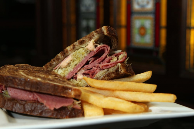 A classic Reuben with a side of french fries