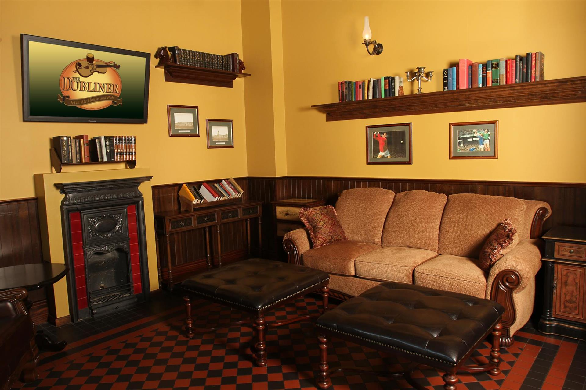 A room in The Dublin with shelves of books and a couch with a coffee table