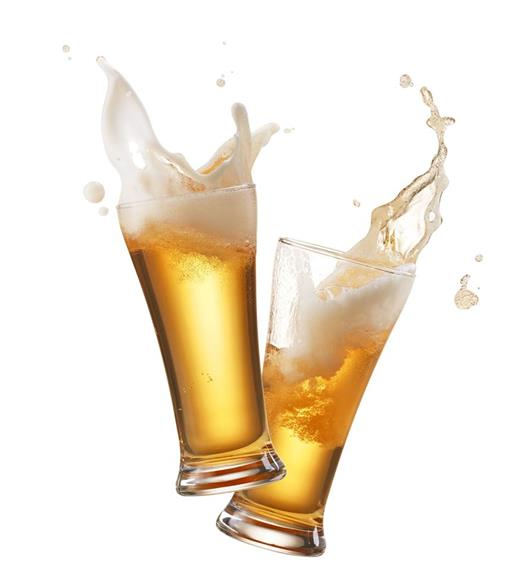 Glasses of Beer splashing into the air