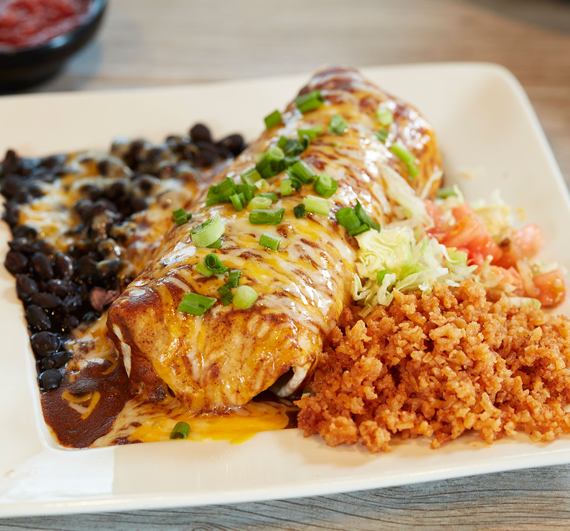 burrito smothered in cheese and enchilada sauce