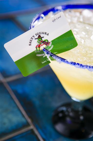 margarita with a gift card hanging over the edge