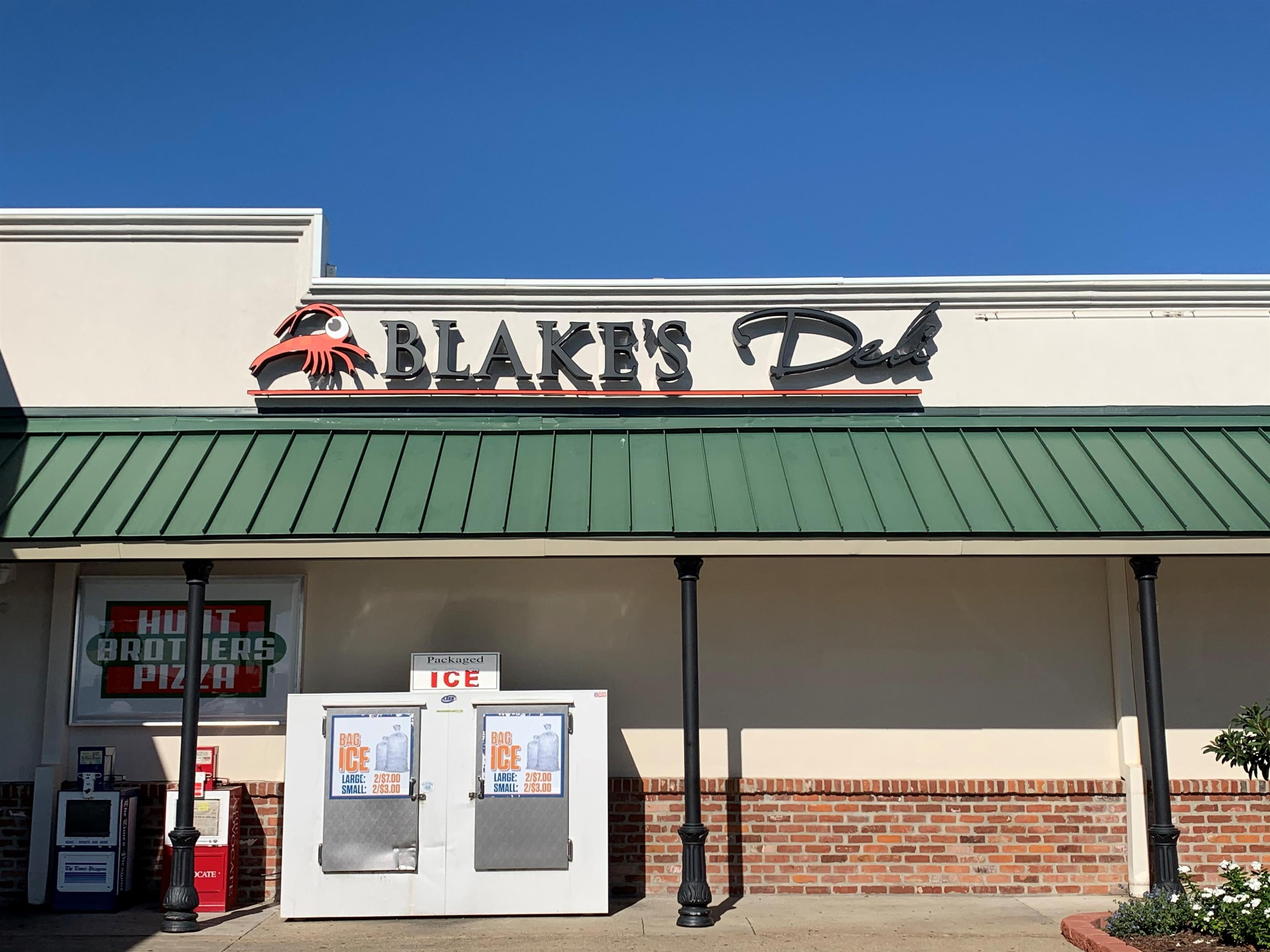Exterior of Blake's deli with ice storage out front