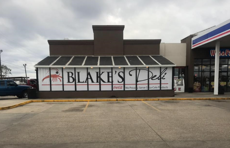 Storefront with sign Blake's Deli