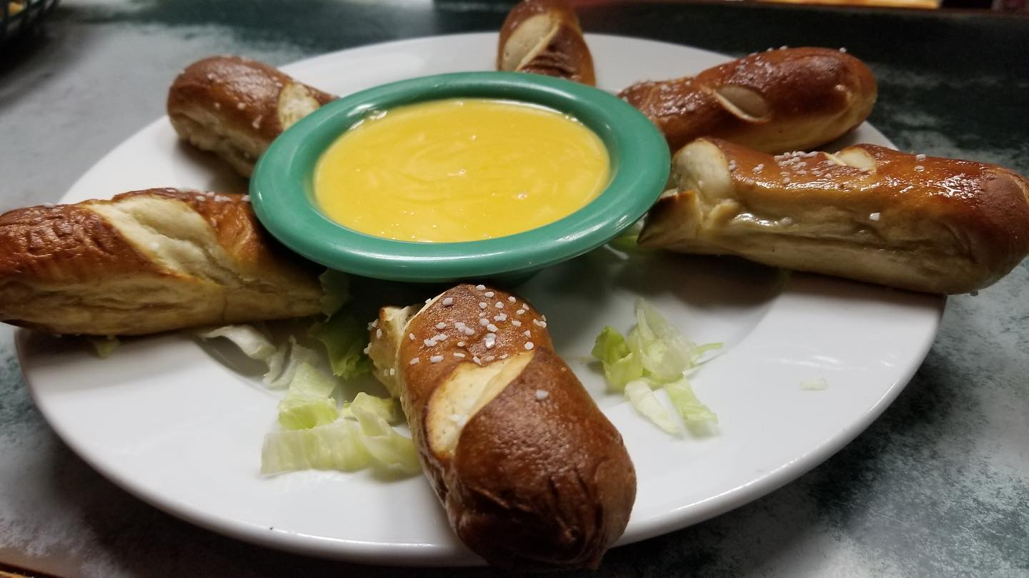 Baked pretzel with dipping beer cheese