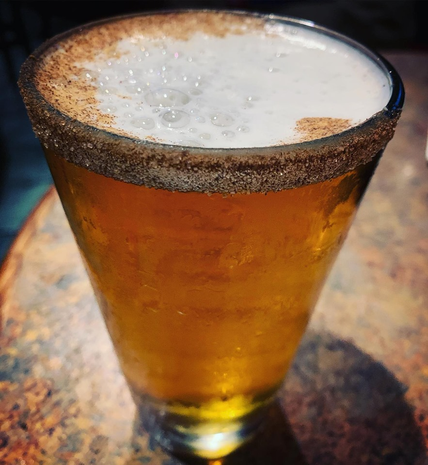 Pint of pumpkin beer with brown sugar rim