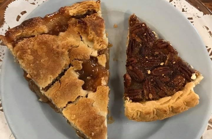 one piece of apple pie and one piece of pecan pie.