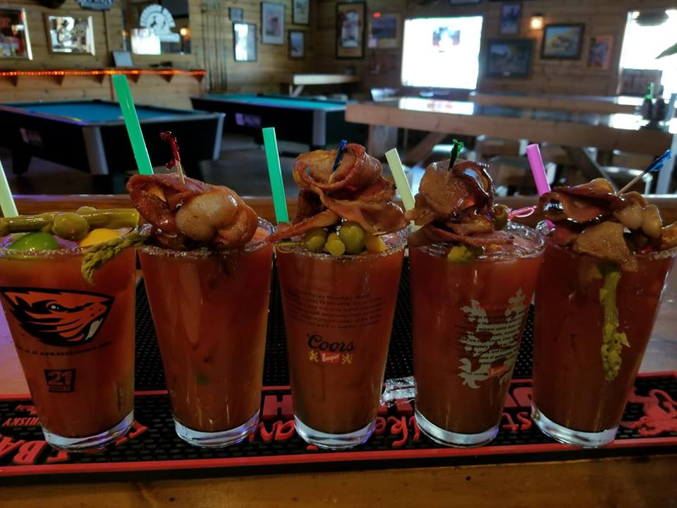 5 bloody marys lined up on the bar