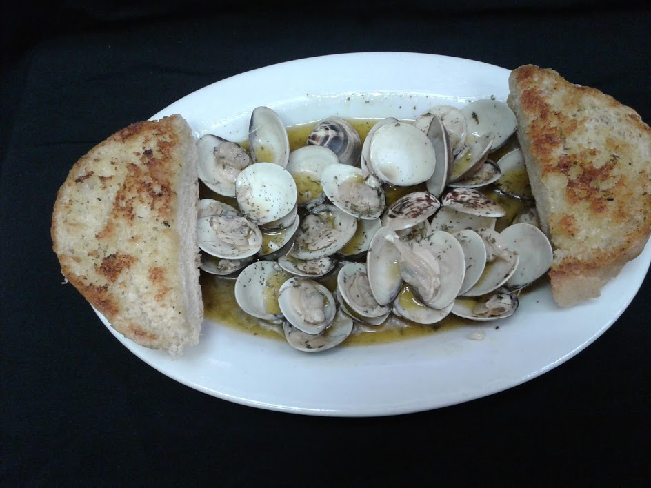 Clams sautéed in garlic butter and served with garlic bread.
