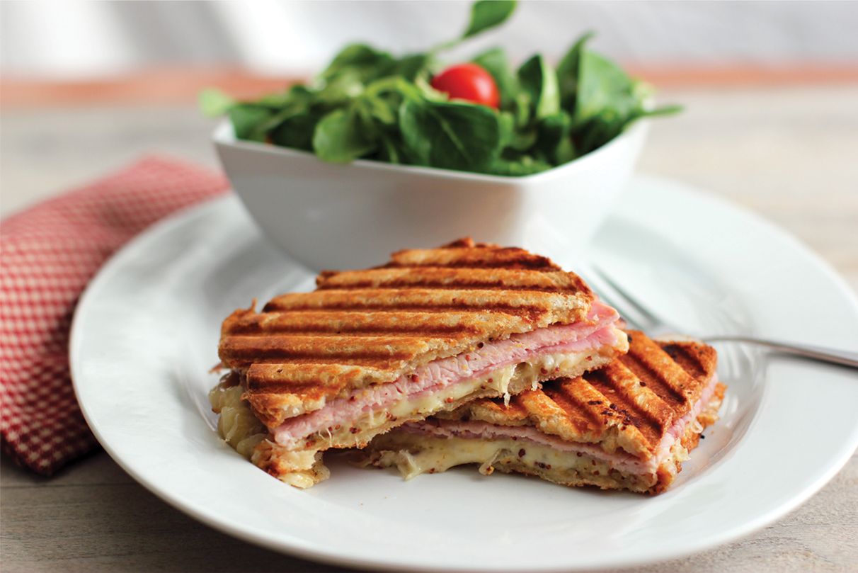 ham and cheese panini with a side salad