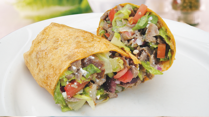 Mediterranean Wrap Filled with chopped lettuce, tomatoes, red onions, feta cheese and authentic gyros meat and drizzled with a Greek vinaigrette.