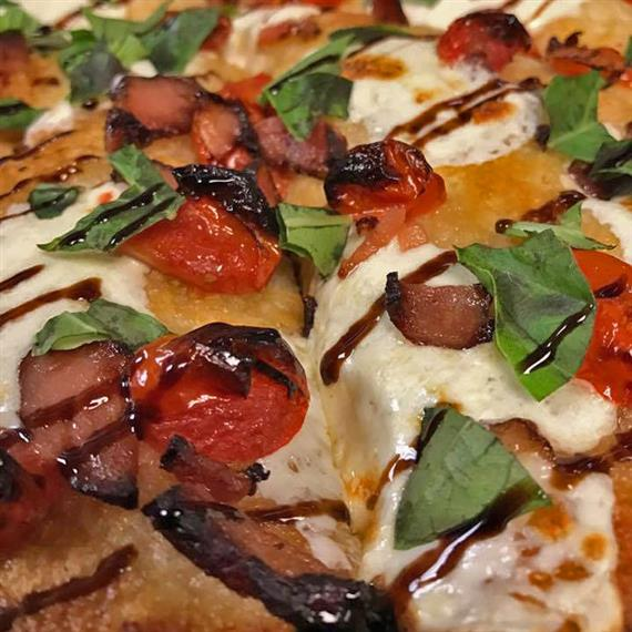 A close-up view of our fresh tomato and basil balsamic pie