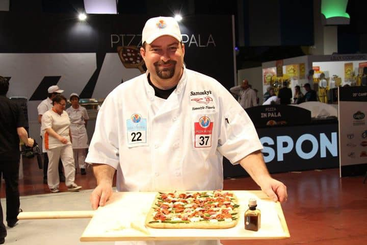 Jason displaying his pizza at a competition