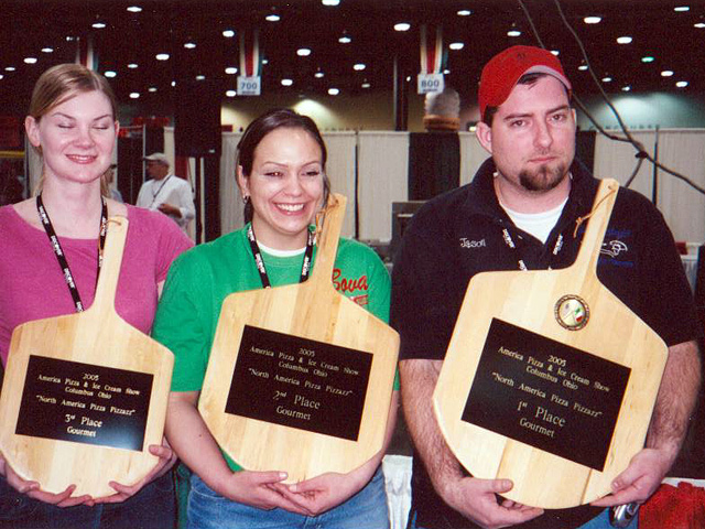 Jason holding up an award with two other chefs