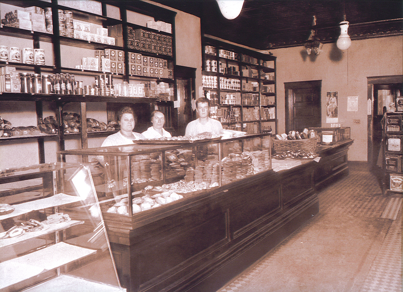 Vintage photo of original staff working behind the counter at Samosky's Homestyle Pizzeria