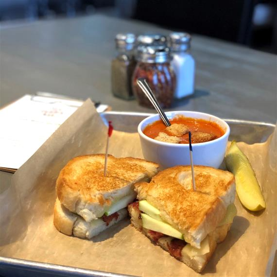 Gruyere and white cheddar cheese, bacon and sliced Granny Smith apple on a fresh grilled sourdough. Served with Tomato Basil Soup.
