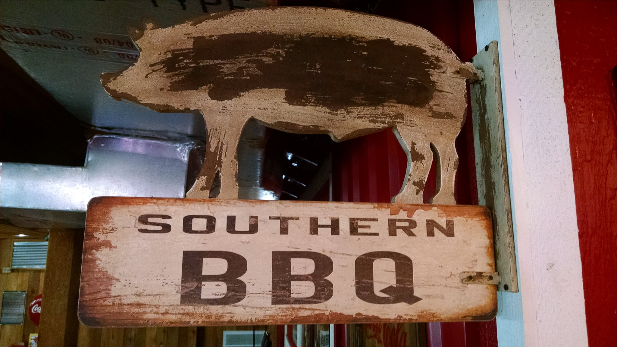 "decorative sign inside the building of a pig that says ""Southern BBQ"""