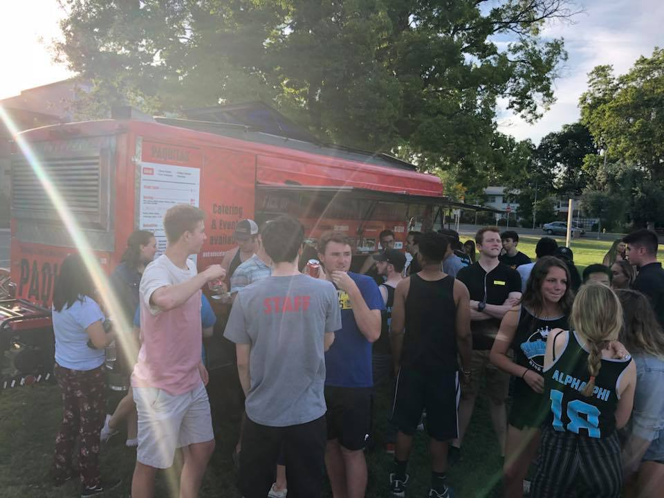 Group of people gathered around Paquitas Mexican Grill Food Truck