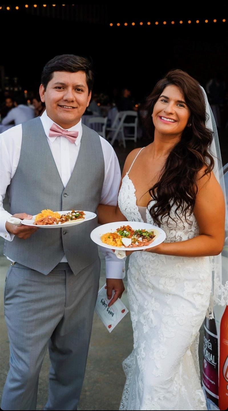 Bride and Groom at an event with two plates full of food