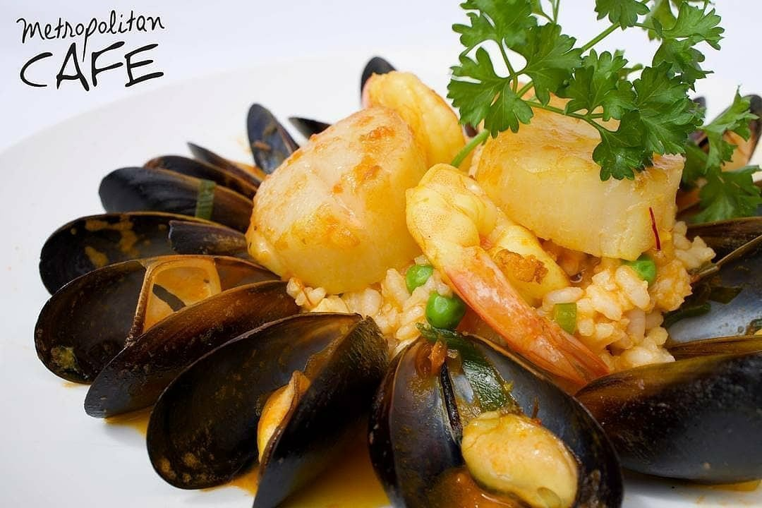 Mussels, shrimp, and scallops on risotto