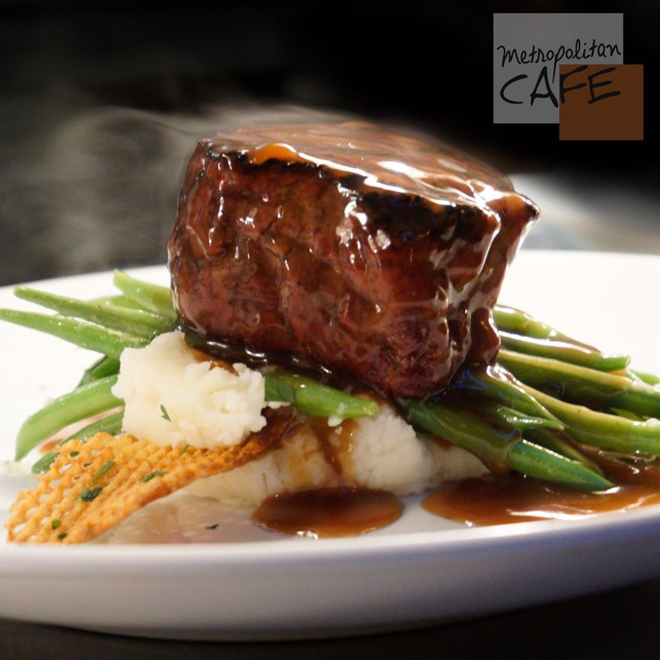 Filet mignon steak on stop of green beans and mashed potatoes
