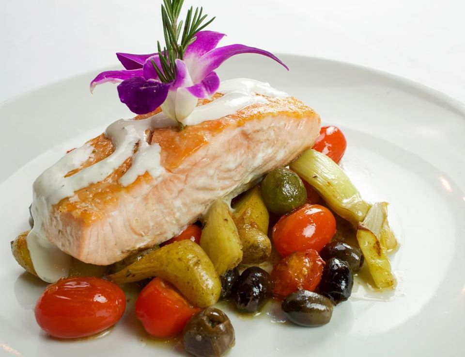 pan roasted salmon on top of vegetables-min