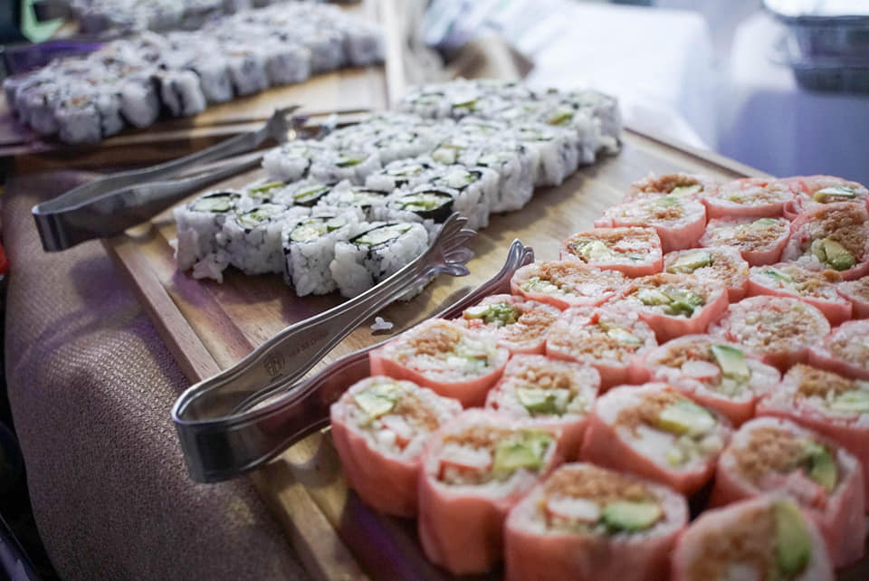 Sushi lined on wooden board