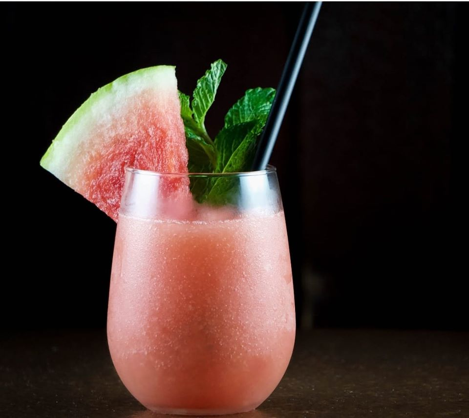 Watermelon cocktail with watermelon garnish slice