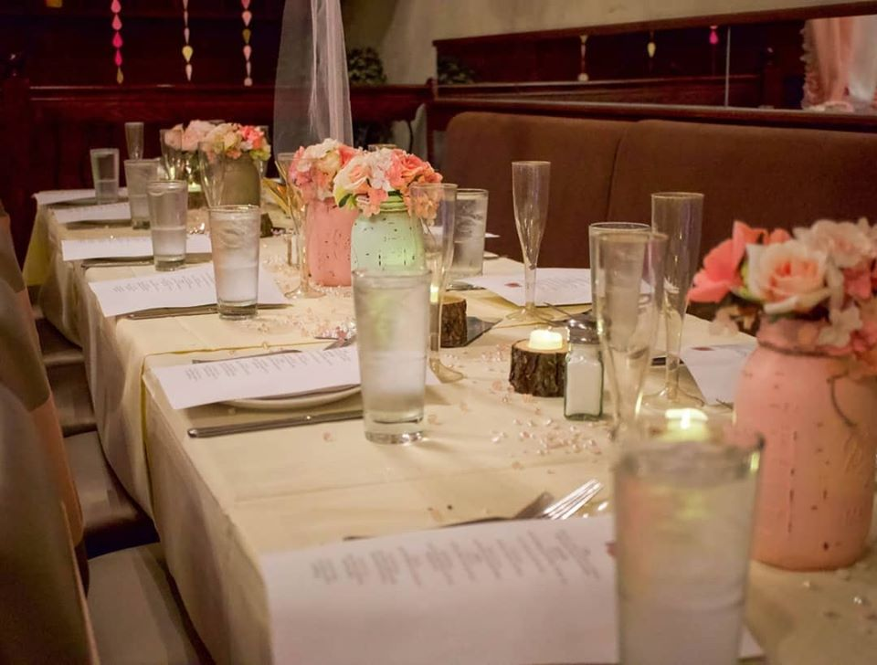 Table setting with glassware and flowers