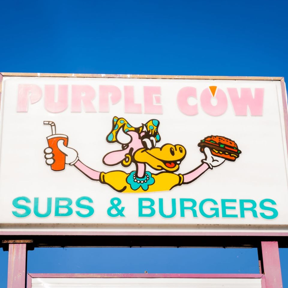 "sign out front that sayd ""Purple Cow Subs & Burgers"""