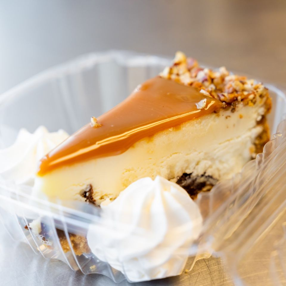 slice of Turtle cheesecake with whipped cream
