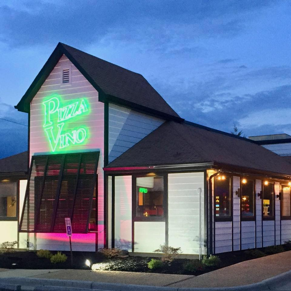 exterior of pizza vino with neon lights