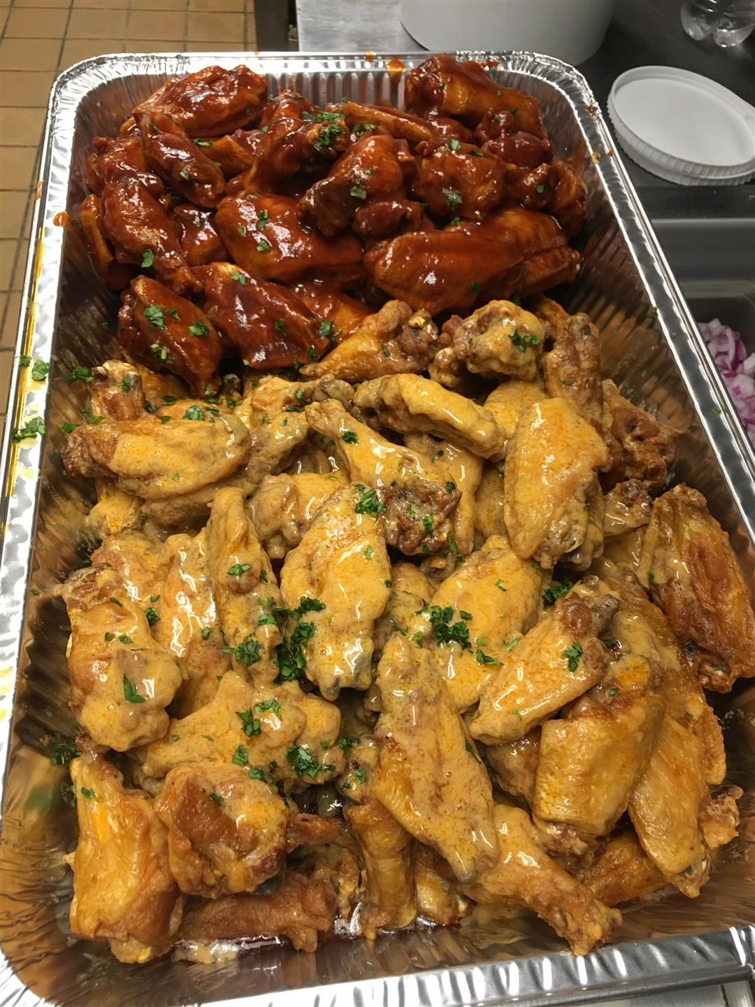 assortment of wings in a tray