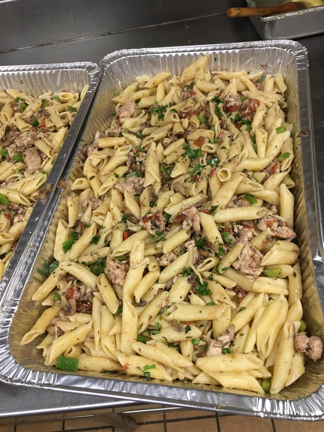 two trays of penne pasta