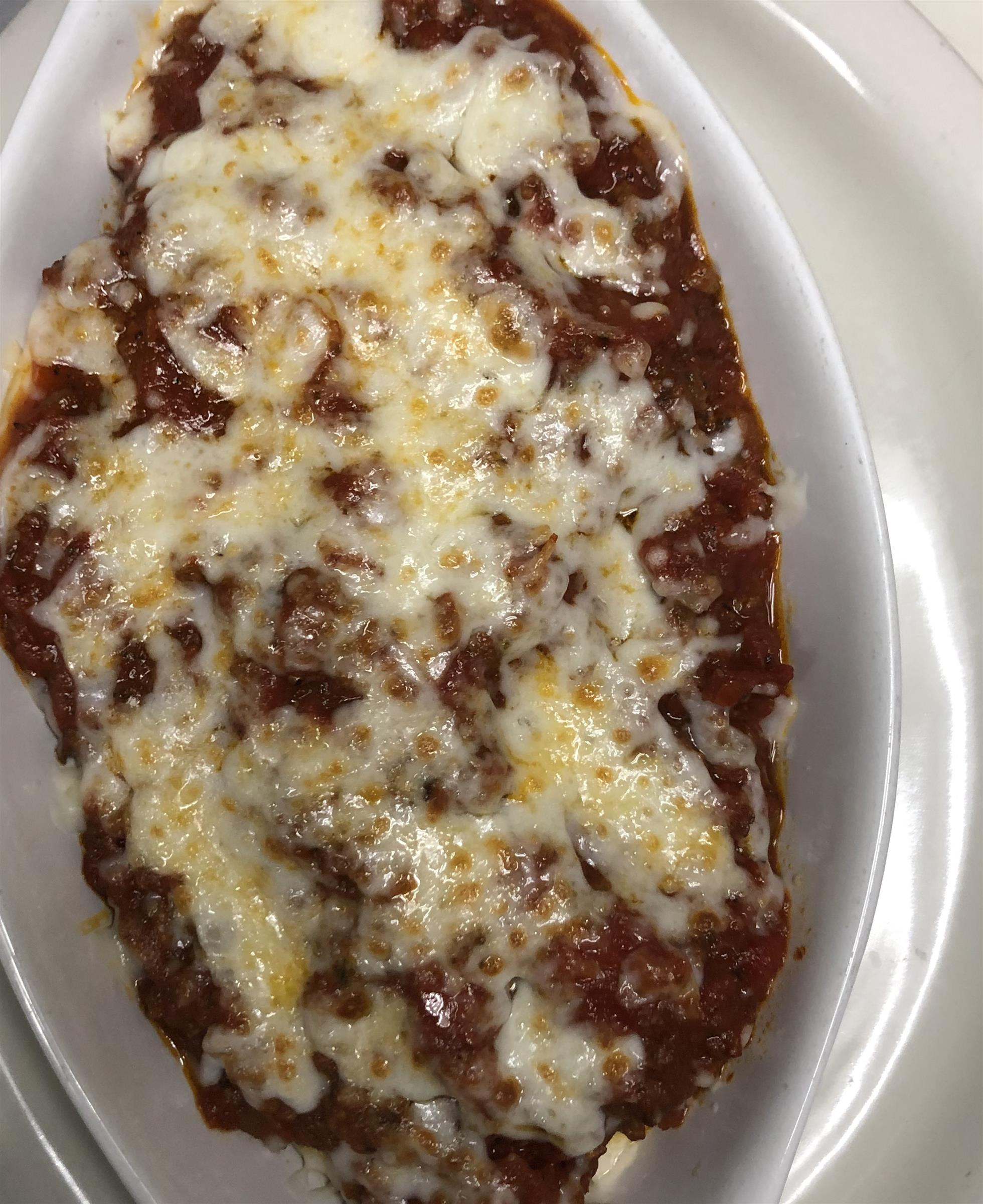 chicken parmesan topped with sauce and cheese