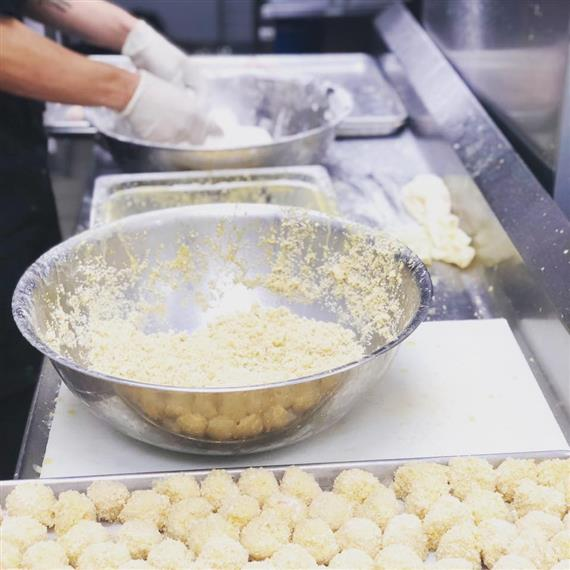 Hands preparing sauerkraut balls
