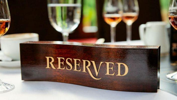 Wooden Reserved sign on a set table