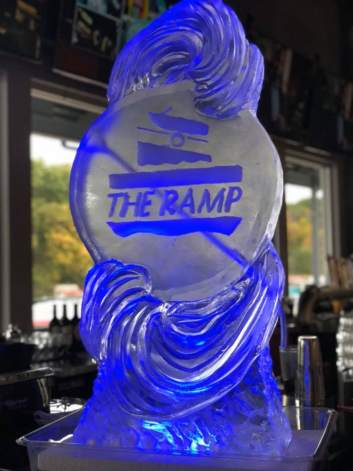 "An ice sculpture that has ""The Ramp"" engraved into it"