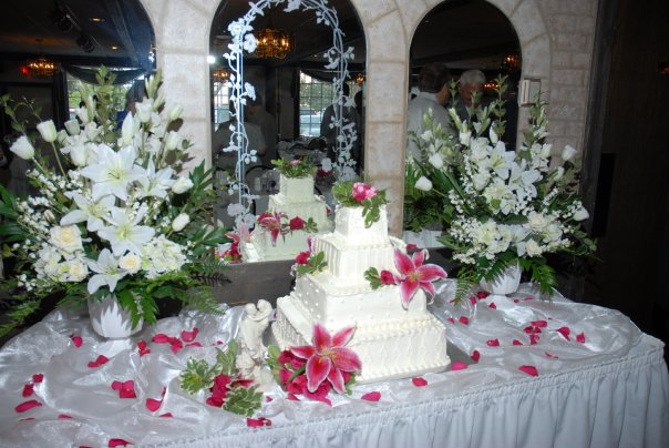 wedding cake on table with floral decor
