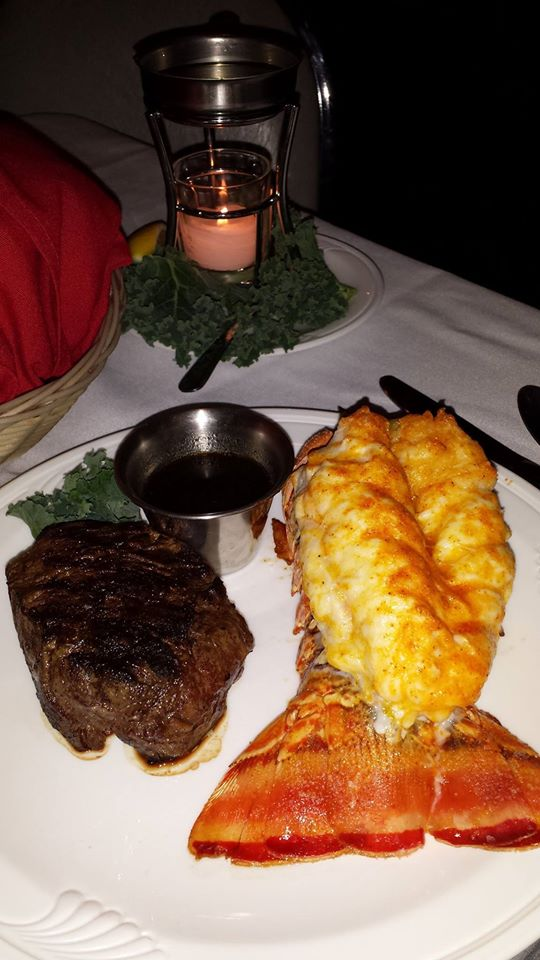 Grilled filet mignon and lobster tail on a dish