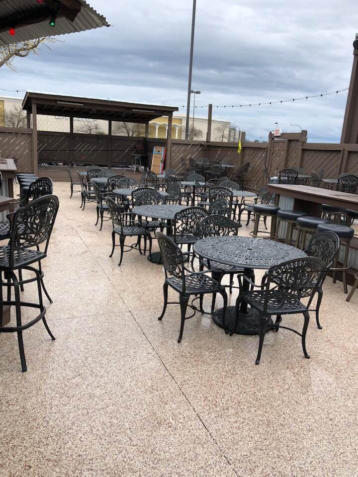 Outdoor patio with empty tables and chairs